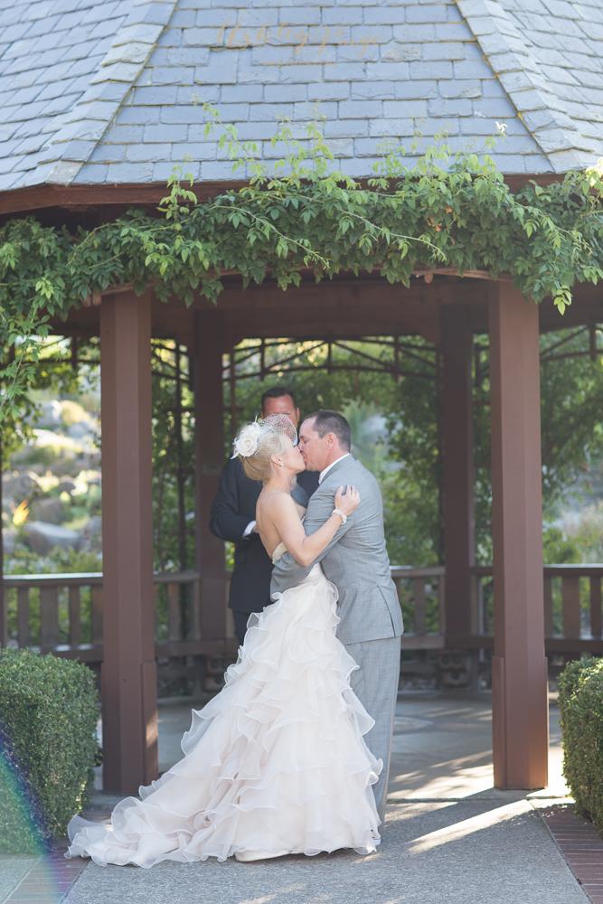 A wedding kiss at our garden gazebo.