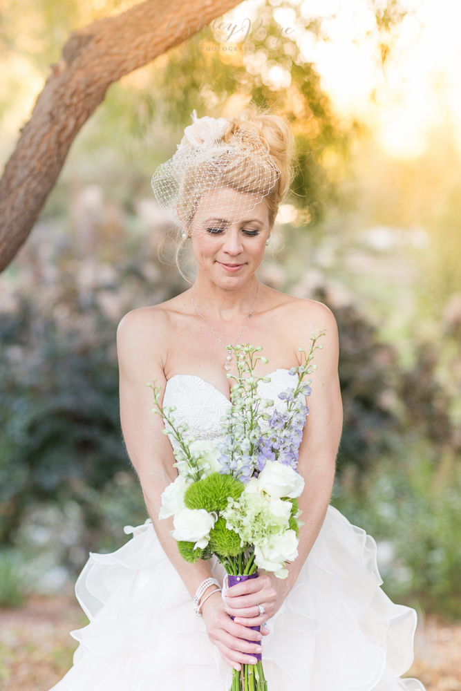 A flirty and fun bride in the garden on her wedding day.