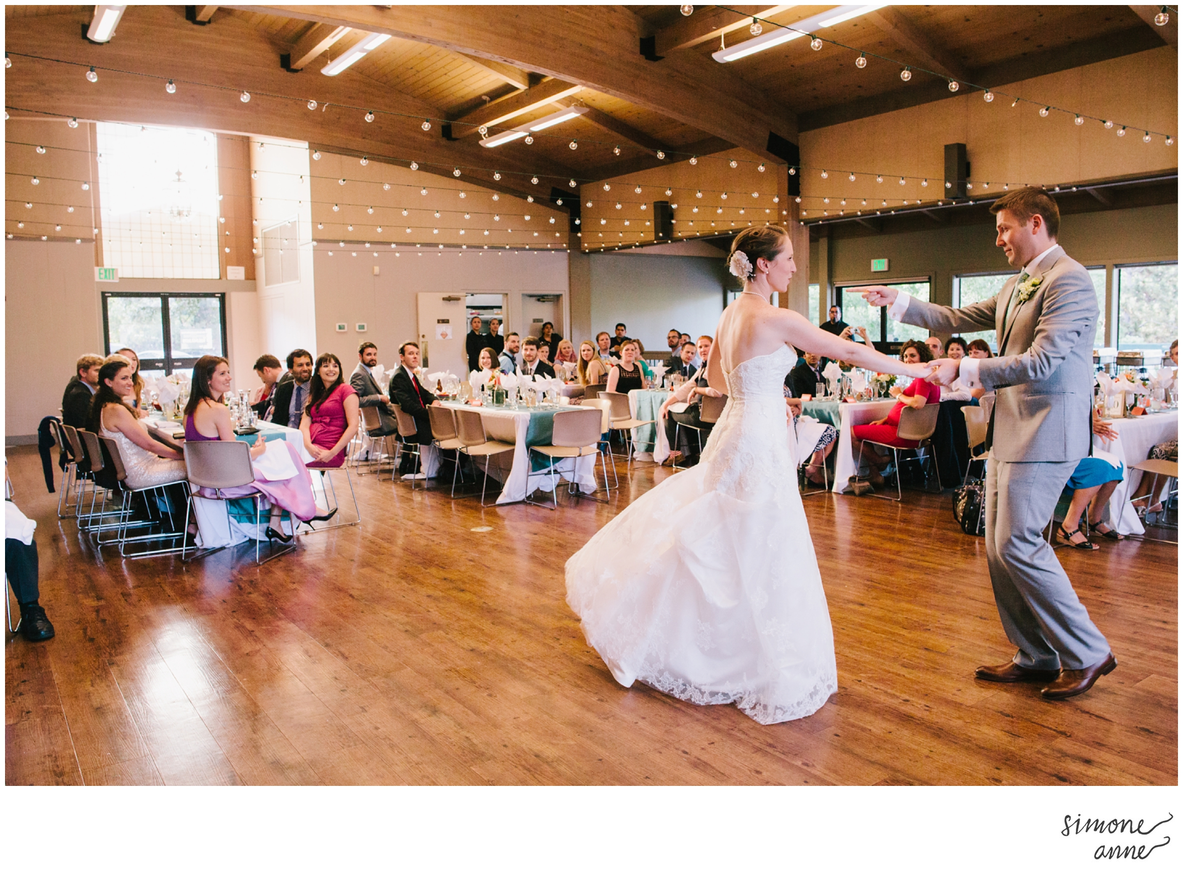 Bride and groom dance away before their guests at an afternoon wedding in the Camellia Room.