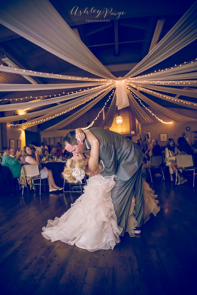 Bride and groom share a romantic first dance at their wedding reception in the Camellia Room.